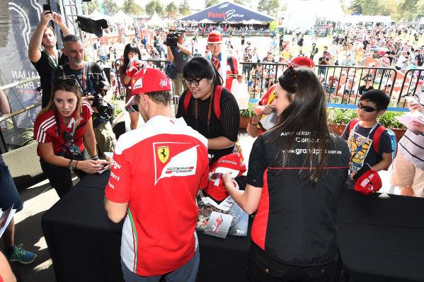 Sebastian Vettel (GER) Ferrari signs autographs for the fans at Formula One World Championship, Rd1, Australian Grand Prix, Preparations, Albert Park, Melbourne, Australia, Thursday 17 March 2016.