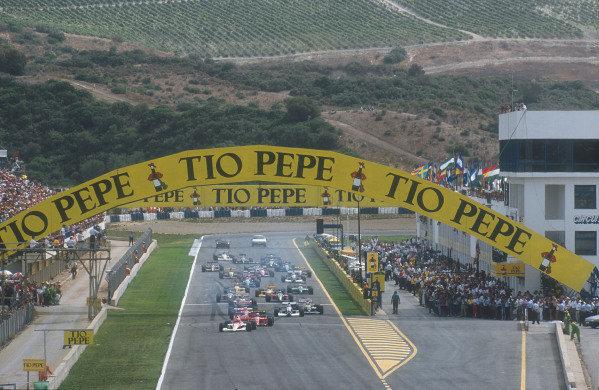1990 Spanish Grand Prix.Jerez, Spain.28-30 September 1990.Ayrton Senna (McLaren MP4/5B Honda) leads Alain Prost, Nigel Mansell (both Ferrari 641's), Jean Alesi (Tyrrell 019 Ford), Gerhard Berger (McLaren MP4/5B Honda), Riccardo Patrese, Thierry Boutsen (both Williams FW13B Renault's), Nelson Piquet and Alessandro Nannini (both Benetton B190 Ford's) at the start.Ref-90 ESP 13.World Copyright - LAT Photographic
