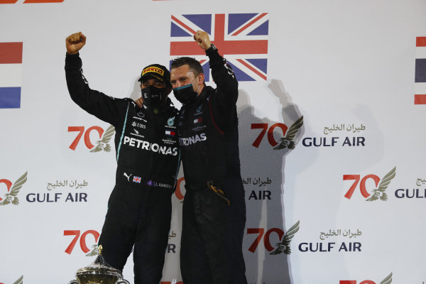 Lewis Hamilton, Mercedes-AMG Petronas F1, 1st position, and the Mercedes trophy delegate celebrate on the podium