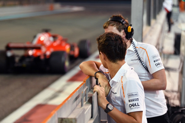 Lando Norris, McLaren watches Charles Leclerc, Ferrari SF-71H