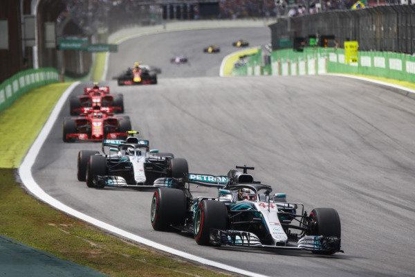 Lewis Hamilton, Mercedes AMG F1 W09, leads Valtteri Bottas, Mercedes AMG F1 W09, Sebastian Vettel, Ferrari SF71H, and Kimi Raikkonen, Ferrari SF71H.