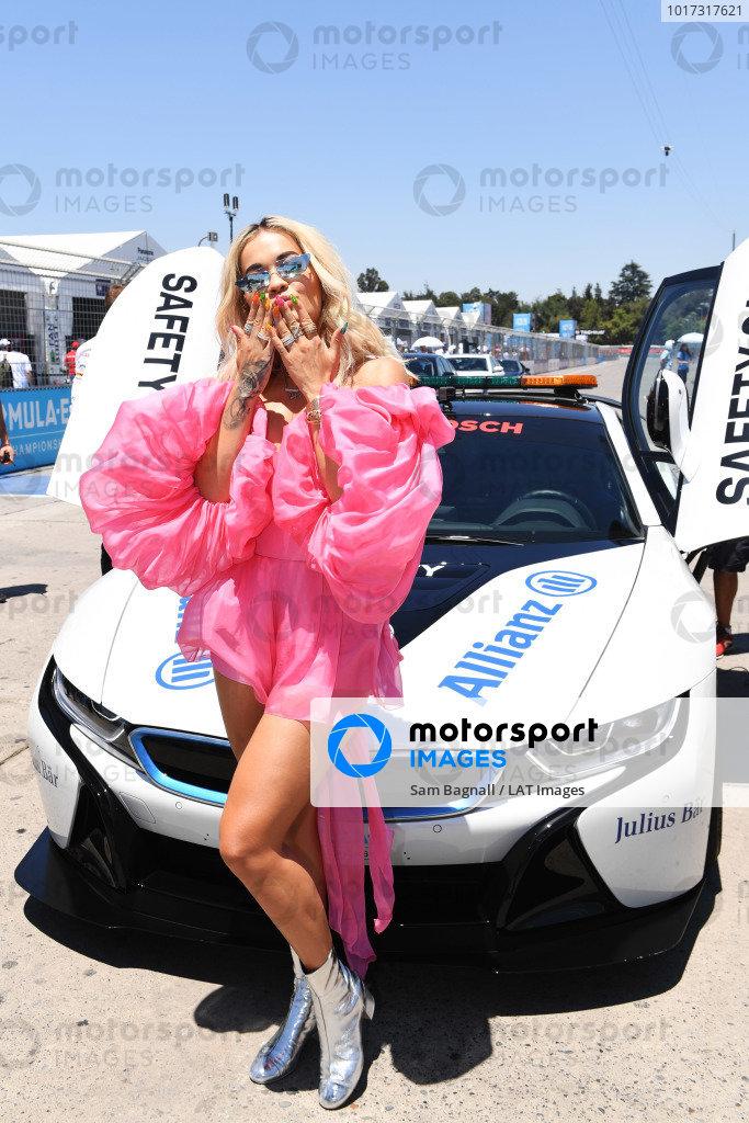 Rita Ora with the Qualcomm BMW i8 Safety car