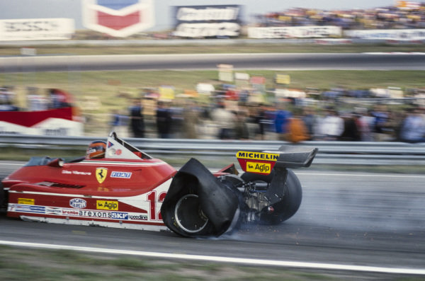 The left rear tyre of Gilles Villeneuve's Ferrari 312T4 explodes but he continues running, damaging his suspension in the process.