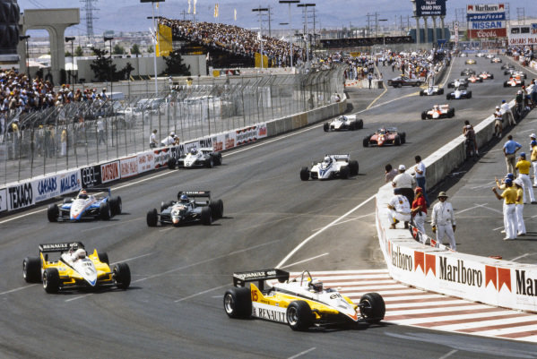 Alain Prost, Renault RE30B, leads René Arnoux, Renault RE30B, Michele Alboreto, Tyrrell 011 Ford, Eddie Cheever, Ligier JS19 Matra, Riccardo Patrese, Brabham BT50 BMW, and Keke Rosberg, Williams FW08 Ford, at the start.