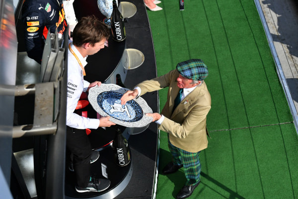 Sir Jackie Stewart, 3-time F1 Champion, presents the Constructors trophy
