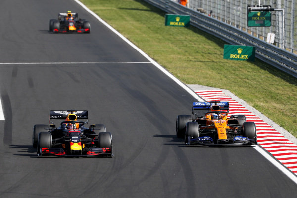 Max Verstappen, Red Bull Racing RB15, puts a lap on Carlos Sainz Jr., McLaren MCL34