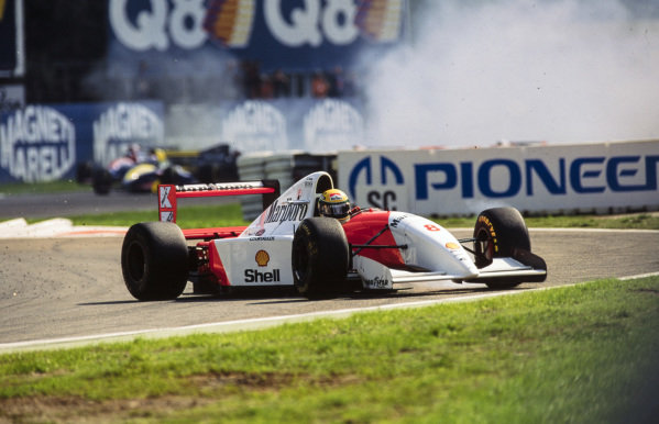Ayrton Senna, McLaren MP4-8 Ford, runs wide after contact at the first chicane.