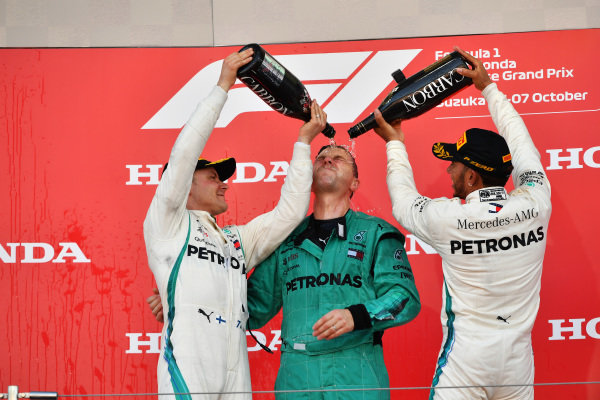 (L to R): Valtteri Bottas, Mercedes AMG F1, Matt Deane, Mercedes AMG F1 Chief Mechanic and Lewis Hamilton, Mercedes AMG F1 celebrate on the podium with the champagne