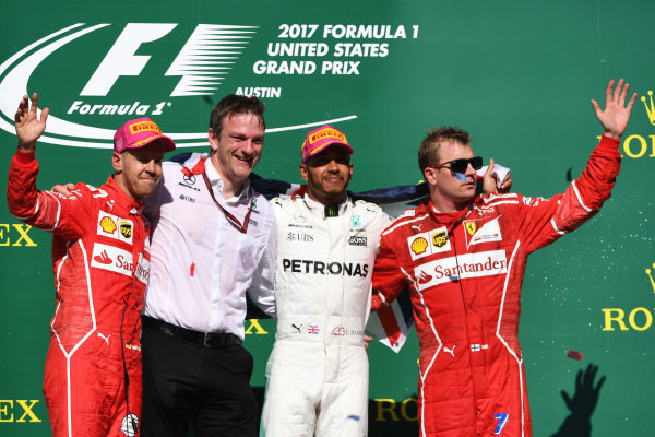(L to R): Sebastian Vettel (GER) Ferrari, James Allison (GBR) Mercedes AMG F1 Technical Director, Lewis Hamilton (GBR) Mercedes AMG F1 and Kimi Raikkonen (FIN) Ferrari celebrate on the podium at Formula One World Championship, Rd17, United States Grand Prix, Race, Circuit of the Americas, Austin, Texas, USA, Sunday 22 October 2017.