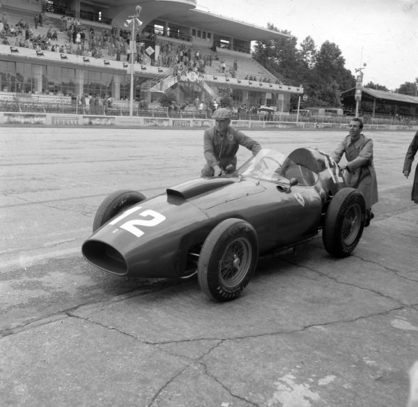 The Ferrari 412 MI is pushed down the pitlane.