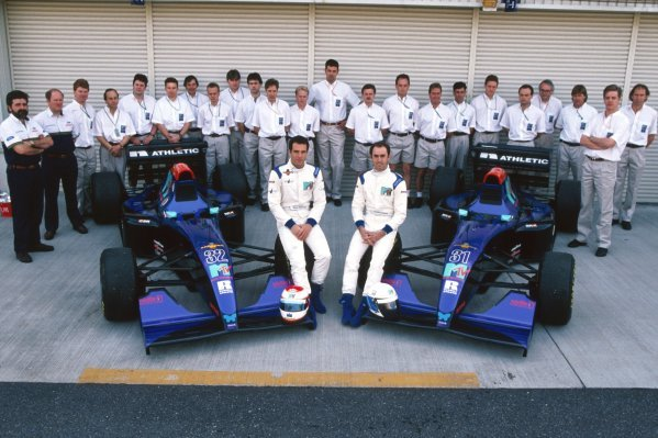 A team photo for the fledgling Simtek team, with drivers Roland Ratzenberger (AUT) (Left) and David Brabham (AUS) (Right) in the foreground with the two Simtek S941Ã•s. Pacific Grand Prix, Rd 2, TI Circuit Aida, Japan, 17 April 1994.