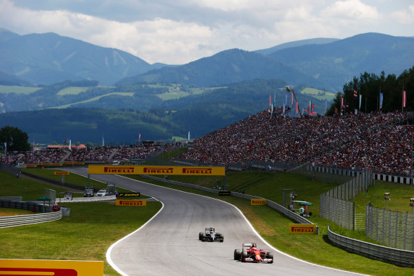 Red Bull Ring, Spielberg, Austria. Sunday 22 June 2014. Kimi Raikkonen, Ferrari F14T, leads Kevin Magnussen, McLaren MP4-29 Mercedes. World Copyright: Steven Tee/LAT Photographic. ref: Digital Image _L4R0616