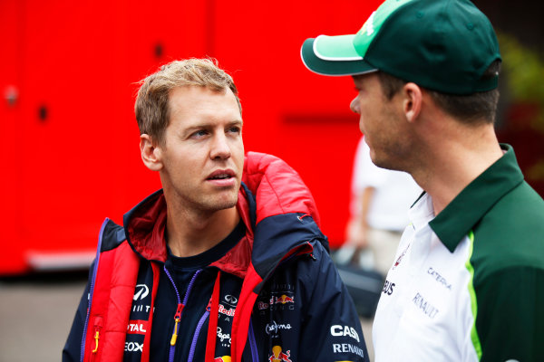 Spa-Francorchamps, Spa, Belgium. Friday 22 August 2014. Sebastian Vettel, Red Bull Racing, and Andre Lotterer, Caterham F1. World Copyright: Charles Coates/LAT Photographic. ref: Digital Image _J5R9287