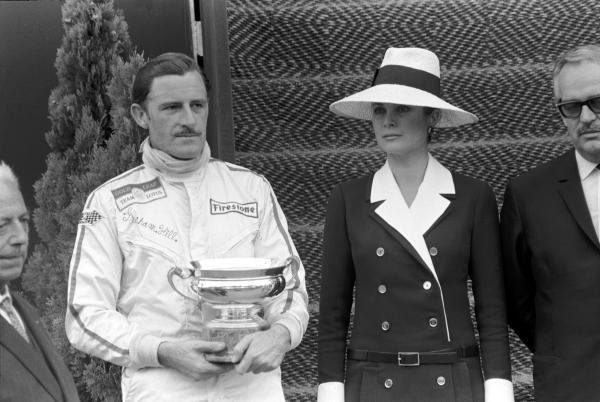 (L to R): Graham Hill (GBR) winner clutching his trophy;  HSH Princess Grace of Monaco and HSH Prince Rainier Monaco Grand Prix, Monte Carlo, 26 May 1968.