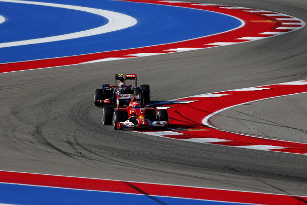 Kimi Raikkonen (FIN) Ferrari F14 T leads Pastor Maldonado (VEN) Lotus E22. Formula One World Championship, Rd17, United States Grand Prix, Qualifying, Austin, Texas, USA, Saturday 1 November 2014.