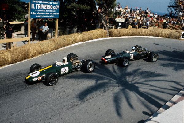 Monte Carlo, Monaco. 26 May 1968.Jack Brabham (Brabham BT26-Repco), retired, leads Piers Courage (B.R M. P126), retired, action. World Copyright: LAT Photographic.Ref: 68MON18.