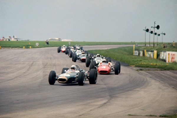 Silverstone, Great Britain. 14th May 1966. Jack Brabham (Brabham BT19-Repco), 1st position, leads John Surtees (Ferrari 312), 2nd position, action.  World Copyright: LAT Photographic. Ref: 66IT06.