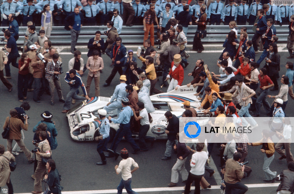 Le Mans, France. 12th - 13th June.Helmut Marko & Gijs van Lennep (Porsche 917K), 1st position, returns to the pits after the race to the cheers of the team and crowd, portrait. World Copyright: LAT PhotographicRef: 71LM
