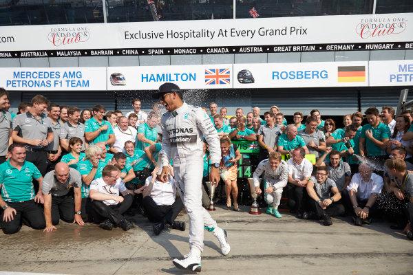 Autodromo Nazionale di Monza, Monza, Italy. Sunday 7 September 2014. Lewis Hamilton, Mercedes AMG, 1st Position, celebrates with his team. World Copyright: Steve Etherington/LAT Photographic. ref: Digital Image SNE15876