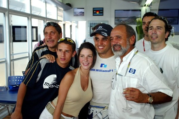 Race winner Juan Pablo Montoya (COL) Williams celebrates victory with Connie Montoya (COL) and his father Pablo Montoya (COL) and Gonzo.Formula One World Championship, Rd12, German Grand Prix, Race Day, Hockenheim, Germany, 3 August 2003.DIGITAL IMAGE
