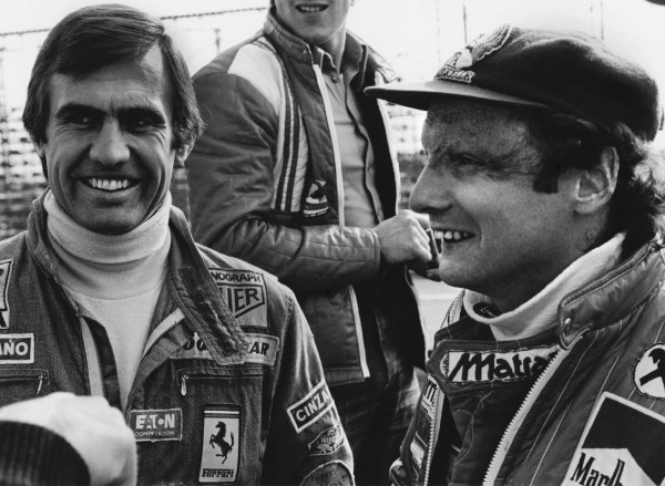 Jarama, Madrid, Spain. 6th - 8th May 1977. Carlos Reutemann and team mate Niki Lauda share a joke in the paddock, portrait. World Copyright: LAT Photographic. Ref: 9793 - 19A.