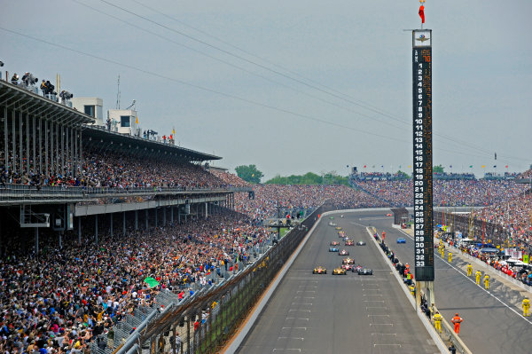 26 May, 2013, Indianapolis, Indiana, USA Eventual winner Tony Kanaan (#11) passes Ryan Hunter-Reay (#1) and Carlos Munoz (#26) for the win as the race returns to green for the final time. ©2013, F. Peirce Williams LAT Photo USA