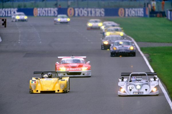 2004 Le Mans Endurance SeriesSilverstone 1000 KilometersSilverstone, England. 12th - 14th August 2004Andrews/Lockie/Jones (Lola-Caterpillar) leads Randaccio/Mancini (Tampolli-Ford). Action.World Copyright: Glenn Dunbar/LAT Photographicref: 35mm Transparency A35