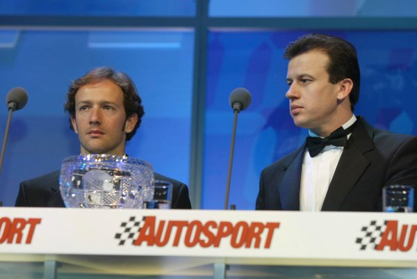 2003 AUTOSPORT AWARDS, The Grosvenor, London. 7th December 2003.Cristiano Da Matta and Olivier Panis present the Paul Warwick trophy for best National driver.Photo: Peter Spinney/LAT PhotographicRef: Digital Image only