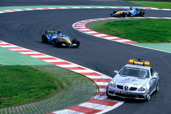 2004 Belgian Grand Prix.Spa Francorchamps, Belgium. 27th - 29th August.The pace car leads Jarno Trulli, Renault R24 and team mate Fernando Alonso, Renault R24 Action. World Copyright:LAT PhotographicRef:35mm Image A15