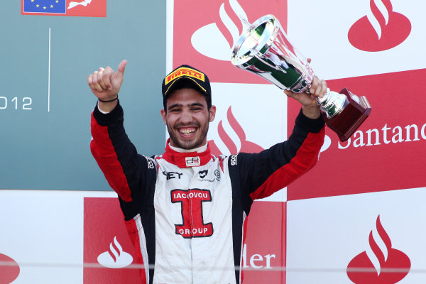 2012 GP3 Series, Round 3.Valencia, Spain. 24th June 2012. Sunday Race 2. Tio Ellinas (CYP, Marussia Manor Racing) celebrates on the podium. Portrait. World Copyright:  Daniel Kalisz/LAT Photographic Ref: Digital Image IMG_2123