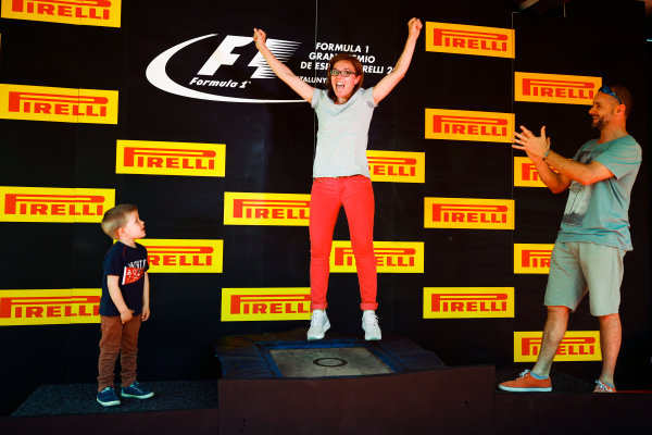 Circuit de Catalunya, Barcelona, Spain. Sunday 14 May 2017. Fans play on the podium in the fan zone. World Copyright: Andy Hone/LAT Images ref: Digital Image _ONZ5852