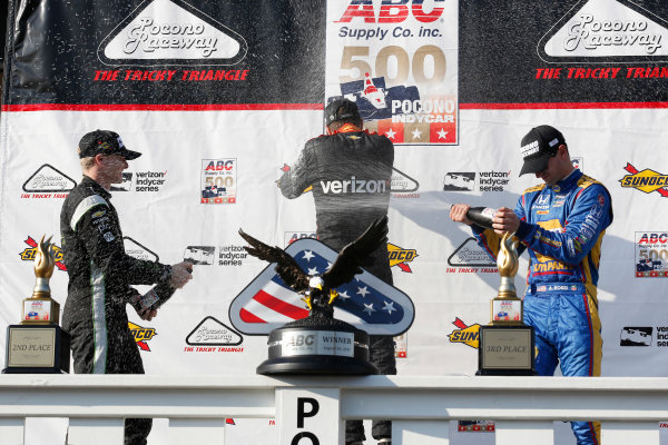 Verizon IndyCar Series ABC Supply 500 Pocono Raceway, Long Pond, PA USA Sunday 20 August 2017 Will Power, Team Penske Chevrolet, Josef Newgarden, Team Penske Chevrolet, Alexander Rossi, Curb Andretti Herta Autosport with Curb-Agajanian Honda celebrate with champagne on the podium World Copyright: Phillip Abbott LAT Images ref: Digital Image abbott_pocono_0817_8082