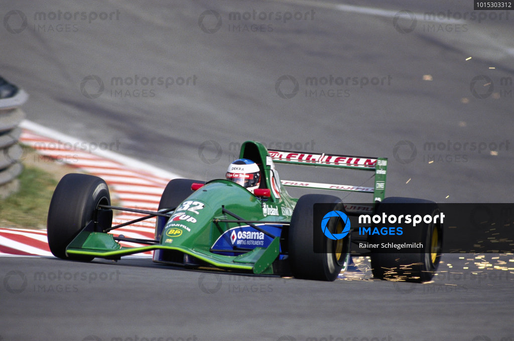 Michael Schumacher, Jordan 191 Ford, with sparks flying at Eau Rouge.