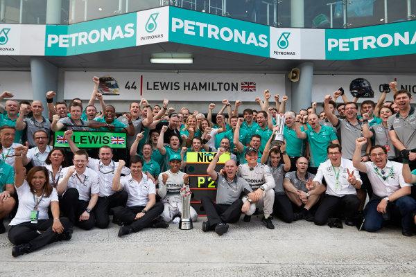 Sepang International Circuit, Sepang, Kuala Lumpur, Malaysia. Sunday 30 March 2014. Lewis Hamilton, Mercedes AMG, and Nico Rosberg, Mercedes AMG, celebrate victory with the team. World Copyright: Steve Etherington/LAT Photographic. ref: Digital Image SNE10976 copy