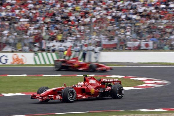 2007 French Grand Prix - Sunday RaceCircuit de Nevers Magny Cours, Nevers, France.1st July 2007.Kimi Raikkonen, Ferrari F2007, 1st position, leads Felipe Massa, Ferrari F2007, 2nd position. Action. World Copyright: Andrew Ferraro/LAT Photographicref: Digital Image VY9E3367