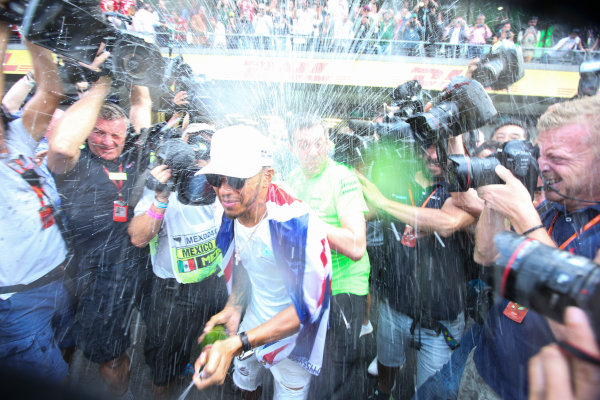 Autodromo Hermanos Rodriguez, Mexico City, Mexico. Sunday 29 October 2017. Lewis Hamilton, Mercedes AMG, sprays Champagne at photographers in celebration of securing his 4th world drivers championship title. World Copyright: Charles Coates/LAT Images  ref: Digital Image DJ5R7723