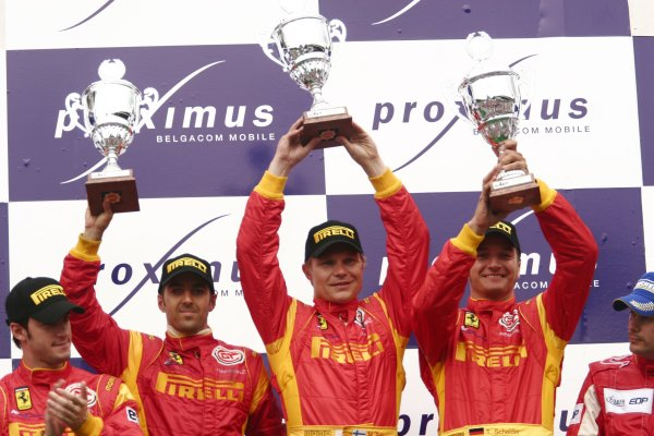 2006 FIA GT Championship.Spa-Francorchamps, France. 29th - 30th July.24 Hours.Mika Salo/Rui Aguas/Timo Schneider, (Ferrari 430 GT2) celebrate on the podium.Portrait.World Copyright: Drew Gibson/LAT Photographic.Ref: Digital Image Only.