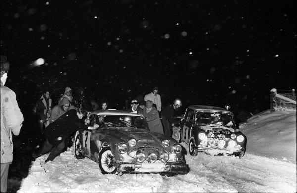 1965 RAC Rally of Great Britain. 10th - 17th November 1965. Rauno Aaltonen / Tony Ambrose (BMC Mini Cooper S), 1st position, with Timo Makinen / Paul Easter (Austin Healey 3000 MK1), 2nd position, stuck in the snow and being given a helping hand by Graham Robson (hood up), portrait.  World Copyright: LAT Photographic.  Ref:  L65 - 626 - 20/20A.