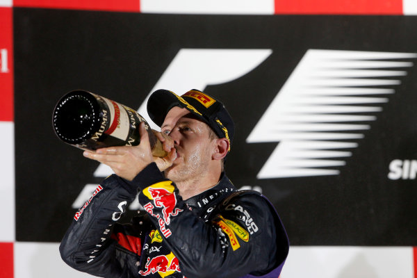 Marina Bay Circuit, Singapore. Sunday 22nd September 2013.  Sebastian Vettel, Red Bull Racing, celebrates on the podium.  World Copyright: Glenn Dunbar/LAT Photographic. ref: Digital Image _89P1397