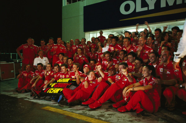 The Ferrari team celebrates six world championships for Michael Schumacher and its fifth successive constructors' championship.