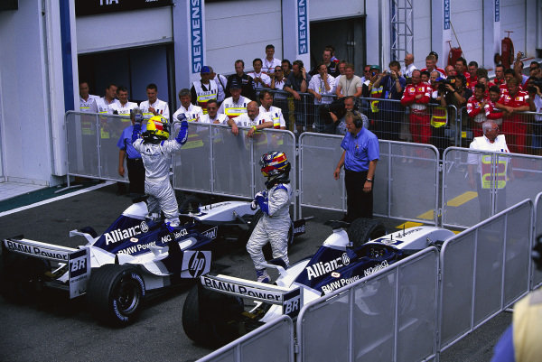 Ralf Schumacher, Williams FW25 BMW, and Juan Pablo Montoya, celebrate a second successive 1-2 after the race.
