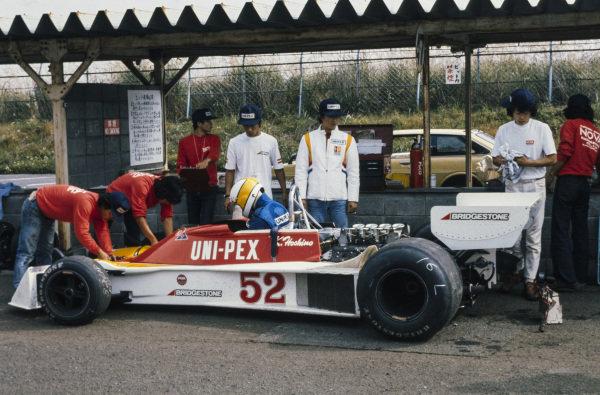 Kazuyoshi Hoshino, Tyrrell 007 Ford in the pitlane.