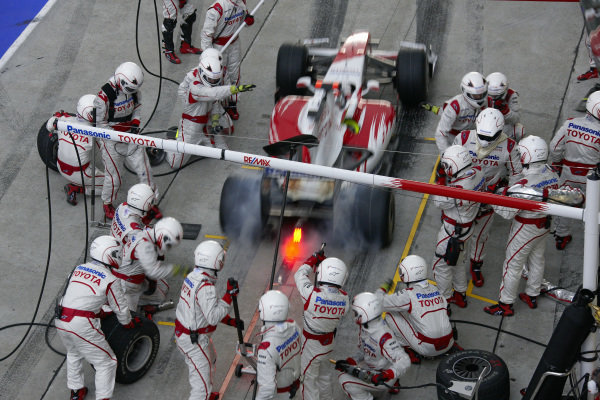Timo Glock, Toyota TF109 lays down rubber leaving his pit box after his stop.