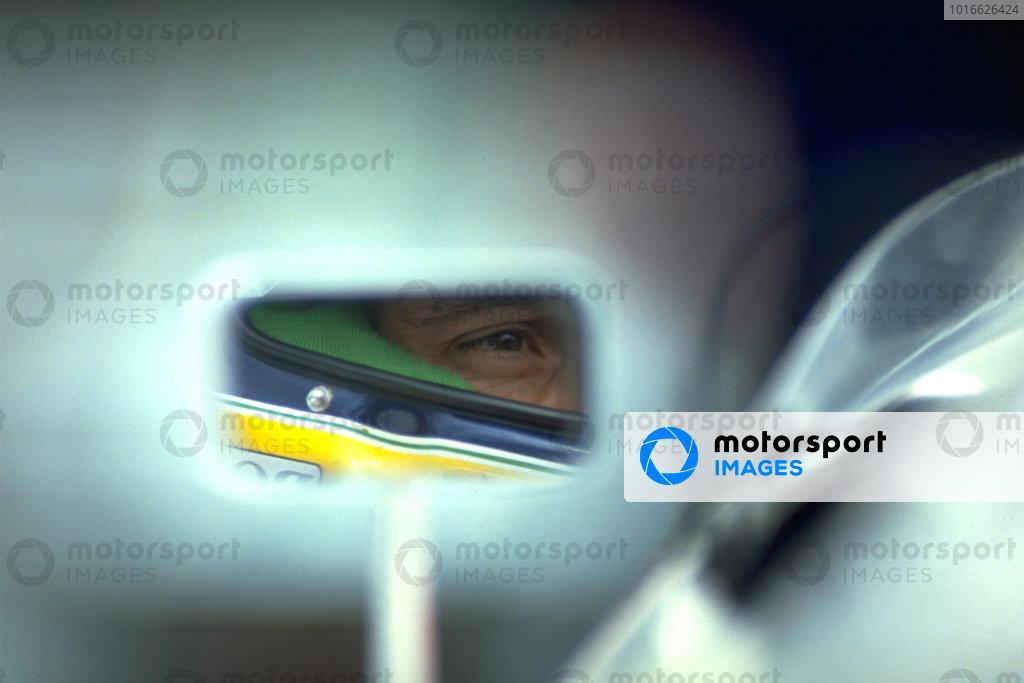 Ayrton Senna is seen in the mirror of his McLaren MP4-6 Honda.