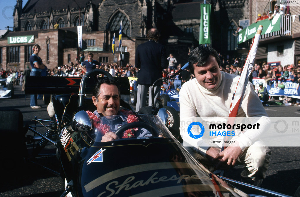 (L to R): Jack Brabham (AUS) and Alan Jones (AUS). Lucas On The Streets Sports Spectacular, Birmingham, England, 12 October 1980.