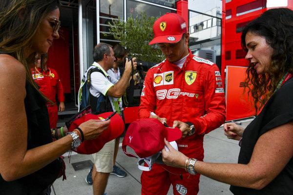 Charles Leclerc, Ferrari, signs autographs for fans