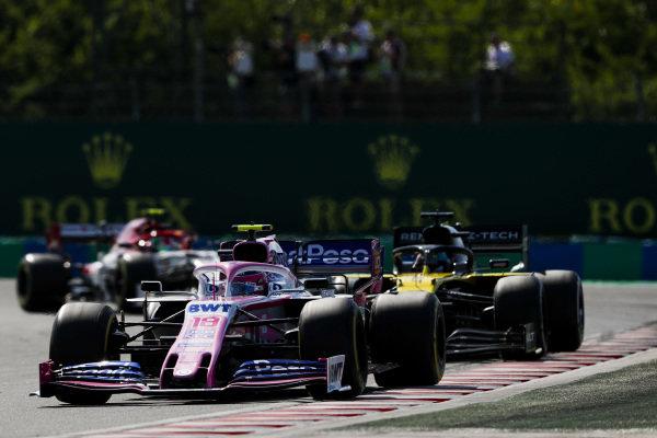 Lance Stroll, Racing Point RP19, leads Daniel Ricciardo, Renault R.S.19, and Antonio Giovinazzi, Alfa Romeo Racing C38