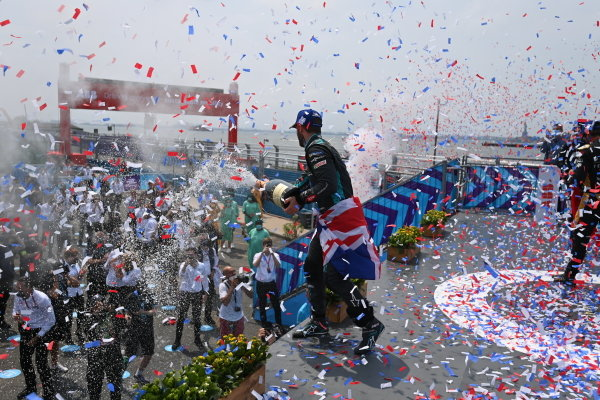 Sam Bird (GBR), Jaguar Racing, 1st position, sprays his Champagne from the podium
