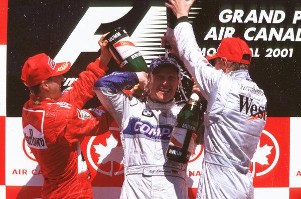 2001 Canadian Grand PrixMontreal, Canada. 8th-10th June 2001Race podium, Ralf Schumacher, BMW Williams FW23 (1st), Michael Schumacher, Ferrari F200 (2nd) and Mika Hakkinen, West McLaren Mercedes MP4/16 (3rd).World Copyright: LAT Photographicref: 35mm Image A22