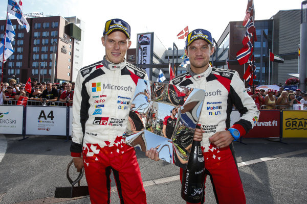 Ott Tanak and co-driver Martin Jarveoja with the spoils of victory